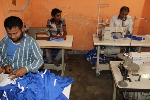 GSI workmen working on sports clothings